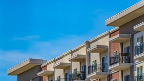 Panorama Exterior of a residential building under blue sky with clouds on a sunny day royalty free stock photo