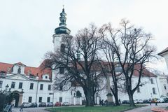 Monastery of fears in prague. Panorama of the facade of the Monastery of Fears in Prague on a cloudy winter day stock image