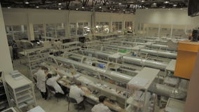 Panorama in Factory with Table Worker Collect Equipment stock footage