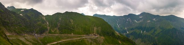 Panorama of Fagaras mountains on a cloudy day. Beautiful summer landscape with famous Transfagarasan road royalty free stock photos