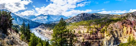Panorama of the famous Fraser Canyon Route following the Thompson River as it flows through the Coastal Mountains. Panorama of the famous Fraser Canyon Route Royalty Free Stock Images
