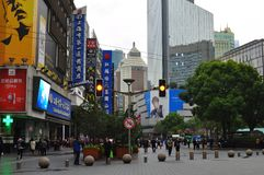 Panorama of the famous Nanjing Road in Shanghai China. A tourism bus Hop in Hop off bus waiting for passengers in the famous Nanjing Road in Shanghai China Royalty Free Stock Photo