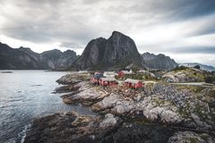 Panorama of famous tourist attraction Hamnoy fishing village on Lofoten Islands near Reine, Norway with red rorbu houses stock photos