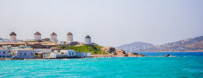 Panorama of famous view of traditional greek windmills on Mykonos island at sunrise, Cyclades, Greece Stock Photo