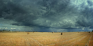 Panorama farm autumn field with dramatic sky Stock Images