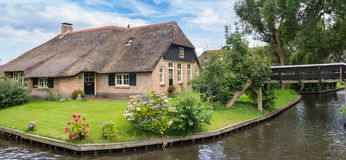 Panorama of a farm with thatched roof in Giethoorn. Holland Stock Image