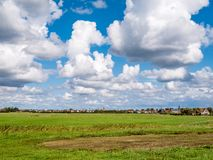 Panorama of farmland and village of Oudeschild on Frisian islan. Panorama of farmland and village of Oudeschild on West Frisian island Texel, North Holland stock images