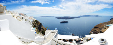 Panorama of the Fira town with view on Aegean sea Royalty Free Stock Image
