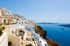 Panorama of Fira with whitewashed buildings carved into the rock on the edge of the caldera cliff on the island of Thira Santorini Stock Photo