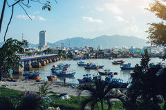 Panorama of fishing boats on river and view city buildings Royalty Free Stock Images