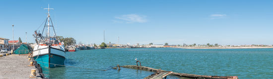 Panorama of fishing ships at the harbor at Laaiplek Stock Photos