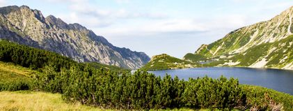 Panorama of Five Polish Lakes Valley. In Tatra mountains range in Tatra National Park. View into direction of Siklawa waterfall Stock Image