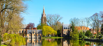 Panorama with Flemish style house reflecting in Minnewater lake, Bruges, Belgium Royalty Free Stock Images