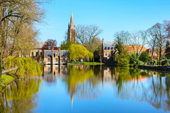 Panorama with Flemish style house reflecting in Minnewater lake, Bruges, Belgium Royalty Free Stock Image
