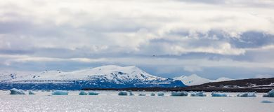 Panorama of floating sea ice in front of snowy mountains in the arctic Royalty Free Stock Photography
