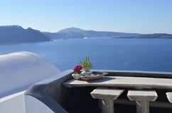 Panorama from the flowers on the Caldera of Oia, Santorini Royalty Free Stock Image