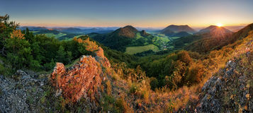 Panorama of forest mountain landscape at sunset Stock Photos