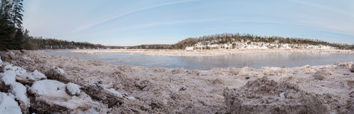 Panorama of forest river covered with snow and ice Royalty Free Stock Photos