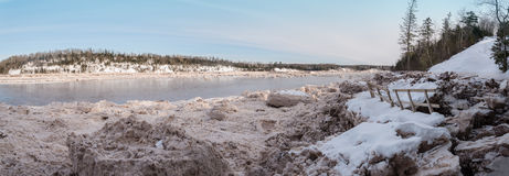 Panorama of forest river covered with snow and ice Royalty Free Stock Photography