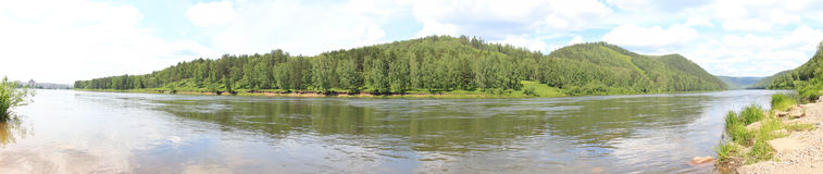 Panorama of forested hills across the river Royalty Free Stock Photography
