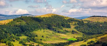 Panorama of forested hills on a cloudy day. Lovely scenery of Carpathian countryside in early autumn stock images