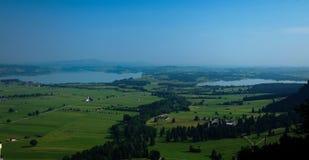 Panorama of Forggensee and Bannwaldsee, Schwangau Bayern Germany. Panorama of Forggensee and Bannwaldsee, Schwangau, Bayern Germany Royalty Free Stock Photo