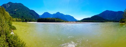 Panorama format photo of the Fraser river in Hope, British Columbia, Canada. Scenic Mountain View Over Fraser River by Hope, British Columbia, Canada stock photography