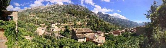 Panorama of Fornalutx rooftops, Mallorca, Spain. Aerial view of Fornalutx outdoors in a mountain valley Stock Photos