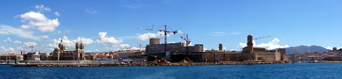 Panorama of Fort Saint-Jean and Cathedral. A panoramic view of the entrance to the vieux port (old harbor) of Marseille, France.  The fortifications of Saint Royalty Free Stock Image