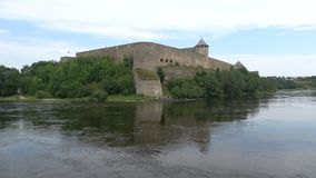 Panorama of the fortress Ivangorod on the Narva river, cloud day in august. Ivangorod, Russia stock footage