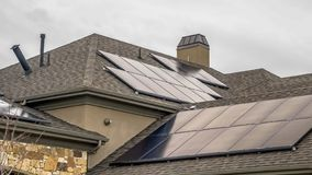 Free Panorama Frame Solar Panels Mounted On The Dark Pitched Roof Of A Home Under Cloudy Gray Sky Royalty Free Stock Photo - 154779315