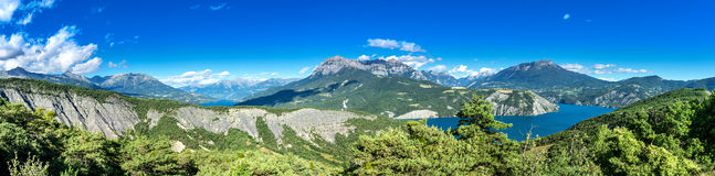 Panorama of the French Alpes. View from the Lac de Serre Poncon to the surrounding mountains stock images