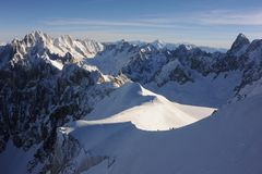 Panorama of French Alps with mountain ranges covered in snow in winter Stock Photos