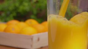 Panorama of fresh orange juice poured in a glass jug
