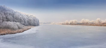 Panorama of frozen river. Stock Image