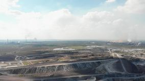 Panorama of fuming plants and quarry. Mining of field minerals-the process of extracting solid, liquid and gaseous minerals from the bowels of the earth with the stock video