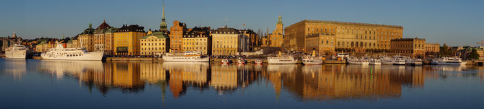 Panorama of Gamla Stan and Royal Castle, Stockholm, Sweden. Panorama with reflections of Gamla Stan, The Old Town, the royal castle, Stockholm Palace, Storkyrkan Stock Photography