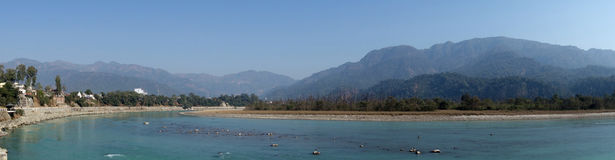 Panorama of Ganges River with Mountains. A panoramic image of the Ganges River in North India in the foothills of the Himalayas near Haridwar Uttarakhsnd India royalty free stock photo