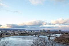 Panorama of Gatineau Hull, in Quebec, facing Ottawa, Ontario, and the Outaouais river, with the iconic Alexandra bridge in front royalty free stock image