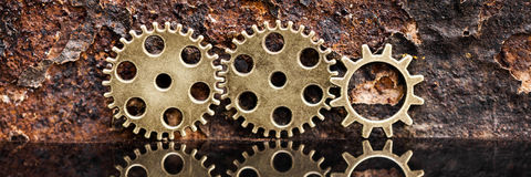 Panorama, gears on rusty background Royalty Free Stock Images