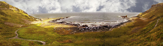 Panorama of giant causeway northern ireland UK. A panoramic image of giant causeway in Northern Ireland United Kingdom UK royalty free stock photo