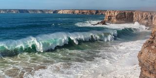 Panorama of giant waves in Sagres. Royalty Free Stock Photo