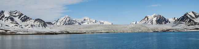 Panorama of glacier above the sea with mountains behind, Svalbar Royalty Free Stock Photo