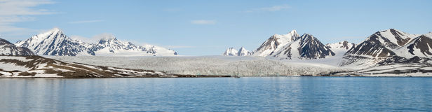 Panorama of glacier above the sea with mountains behind, Svalbar Stock Image