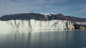 Panorama glacier on border with ocean. Arctic.