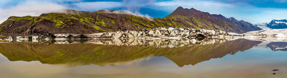 Panorama of glacier and lake at sunrise Royalty Free Stock Photo