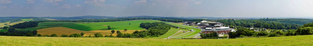 Panorama of Glorious Goodwood. Goodwood Racecourse viewed from the Downs of West Sussex, England Goodwood Racecourse, or Glorious Goodwood as it is known, is a stock photos