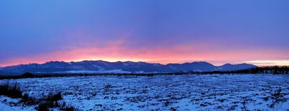 Panorama glow at sunset over the mountains. Stock Images