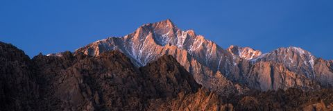 Panorama of Glowing Lone Pine Peak Sunrise, Alabama Hills, Lone Pine, California. The Alabama Hills are a range of hills and rock formations near the eastern Royalty Free Stock Image