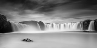 Panorama of Godafoss Waterfall, Iceland. Blur of water of Godafoss Waterfall, Iceland in black and white Stock Photos
